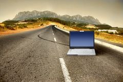 Laptop. On a country road Stock Photo