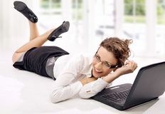 Laptop. Happy young businesswoman with laptop on the floor royalty free stock photos