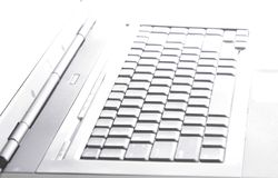 Laptop Abstract. Technology Abstract: Laptop Keyboard, Metallic Surface, White Background Stock Photos
