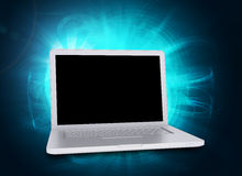 Laptop on abstract blue background, side view Stock Photography