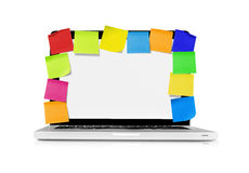 Laptop with adhesive notes Stock Images