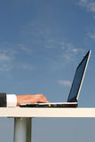 Laptop against blue sky Stock Images