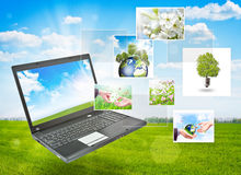 Laptop against green nature background Stock Images