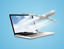 Laptop with airplane. On a blue background Royalty Free Stock Photography