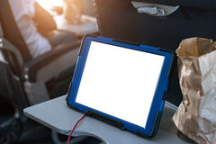 Laptop in the airplane cabin during his business trip. Use a laptop in the airplane cabin during his business trip Stock Image