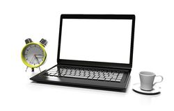 Laptop and alarm clock Stock Image
