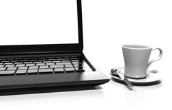 Laptop and alarm clock, 3D illustration. Alarm clock, laptop and cup of hot thea on table Stock Photo