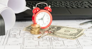 Laptop with alarm clock and money Royalty Free Stock Photo