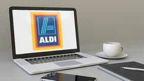 Laptop with Aldi logo on the screen. Modern workplace conceptual editorial 3D rendering Stock Image