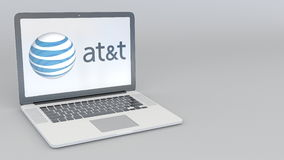 Laptop with American Telephone and Telegraph Company AT&T logo. Computer technology conceptual editorial 3D rendering Royalty Free Stock Photos