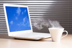Laptop And A Cup Of Coffee Stock Photography