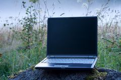 Laptop And Foggy Field Royalty Free Stock Photography