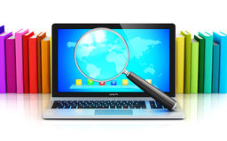 Laptop And Magnifying Glass In Front Of Row Of Color Books Royalty Free Stock Photo