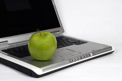 Laptop and apple Stock Photo