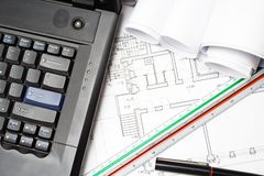 Laptop and architect blueprints Stock Photography