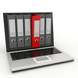 Laptop and archive folders. Stock Photo