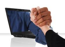 Laptop arm wrestling Stock Photo
