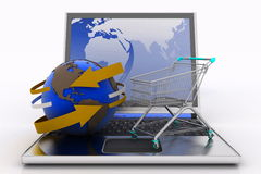 Laptop with arrow and Shopping cart with a globe Stock Photo