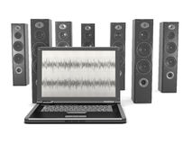 Laptop and audio speakers in background Royalty Free Stock Images