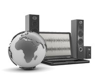 Laptop, audio speakers and earth globe Royalty Free Stock Photo