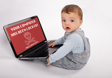 Laptop Baby infected by a ransomware. Adorable baby with laptop infected by a ransomware virus which says the computer has been locked - With white background Royalty Free Stock Photography