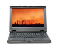 Laptop with bad ecology on screen. Small laptop with bad ecology landscape on screen stock image