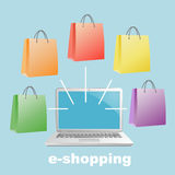 Laptop with bags. Royalty Free Stock Images