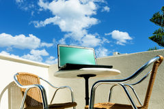 Laptop on balcony Royalty Free Stock Photography