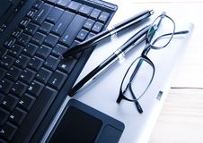 Laptop & Ballpoint & Glasses Royalty Free Stock Photos