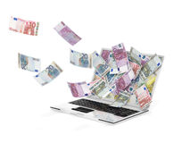 Laptop and banknotes Stock Photos