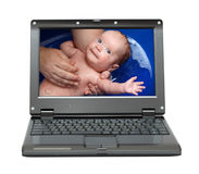 Laptop with bathing baby royalty free stock photography