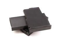 Laptop batteres stacked on white background Stock Image