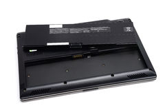 Laptop battery. Rechargerable battery and laptop computer Royalty Free Stock Photo