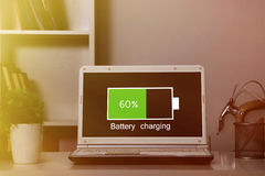 Laptop battery charging Royalty Free Stock Images