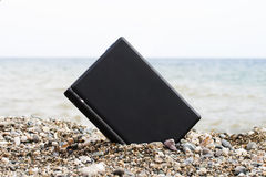 Laptop on the beach Royalty Free Stock Photo
