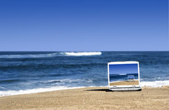 Laptop on the beach Royalty Free Stock Image