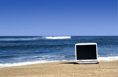 Laptop on the beach Royalty Free Stock Photos