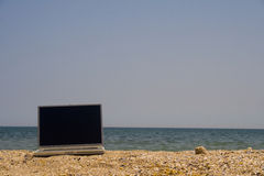 Laptop on beach Royalty Free Stock Image