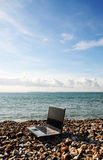 Laptop on beach royalty free stock images