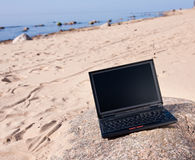 Laptop at beach Royalty Free Stock Photos