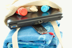 Laptop and beach bag, working and relaxing Royalty Free Stock Photo