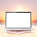 Laptop on beach Stock Images