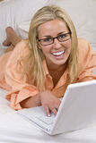 Laptop Beauty In Bed Stock Photo