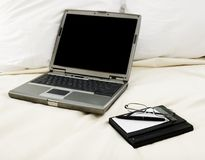 Laptop in bed Royalty Free Stock Photography
