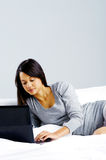 Laptop bed woman happy Stock Photography