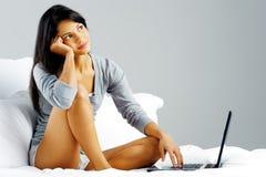 Laptop bed woman happy Stock Photo