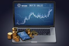 Laptop with Bitcoin chart on-screen among piles of Bitcoin Royalty Free Stock Photography