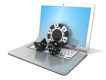 Laptop with black dice and chip. Concept of online gambling Royalty Free Stock Images