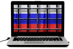 Laptop with black metal bars of a grate and a russian flag on the screen isolated on white background. Russian flag behind black metal bars of a grate on the royalty free stock images