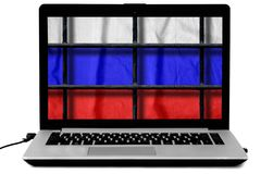 Laptop with black metal bars of a grate and a russian flag on the screen isolated on white background. Laptop with black metal bars of a prison grate and a royalty free stock image